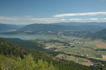 Salmon Arm and Shuswap Lake from Fly Hills. The 10K route crosses the Salmon River flood plain farm land (mid photo)